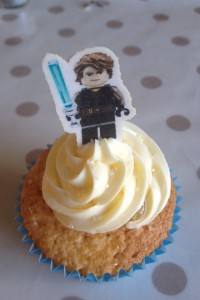 Homemade lemon curd filled lemon cupcakes. Topped with Betty Crocker Vanilla Buttercream & Guarded by Hans Solo xxxxxxx