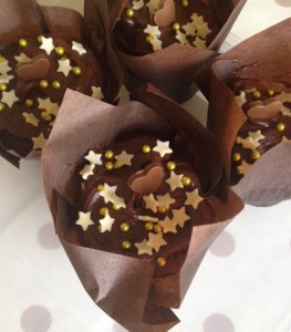 Fudgey, chocolate icing with hearts, stars and gold dragee balls!