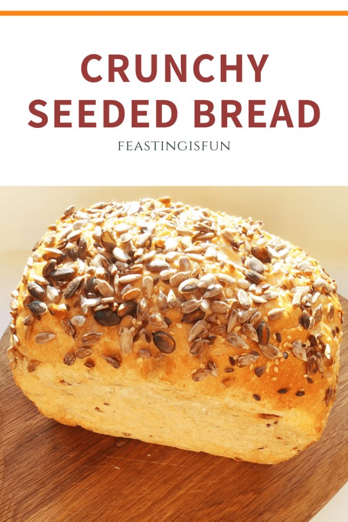 Crunchy Seeded Bread recipe with descriptive graphics for Pinterest.