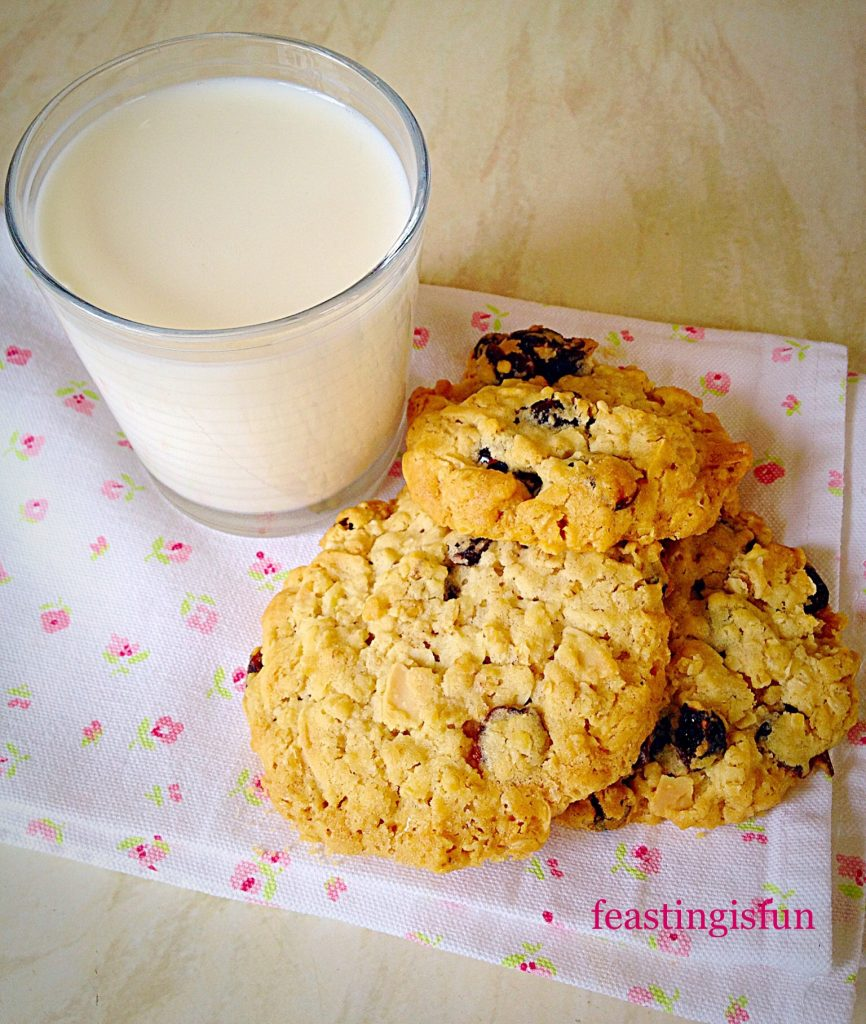 Three biscuits with a glass of milk.