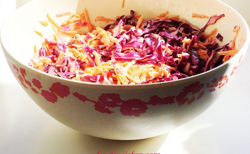 Pretty bamboo fibre bowl with decorative flowers around the outside edge, containing a no cook, easy side dish.