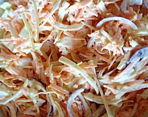 Pretty red onions add a super sweetness to this Coleslaw!