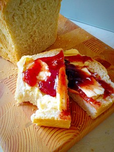 Buttered and slathered in strawberry jam. The best Crusty White Bread ever!!