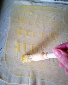 Brush the rolled out pastry with melted butter.