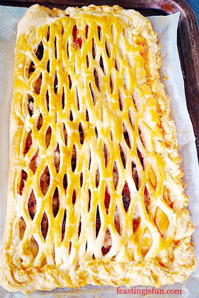 Lattice puff pastry topped savoury sausage meat pastry.