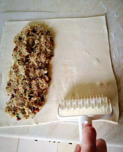 Pat the sausage mixture so that it is spread evenly. Then get ready to roll.....