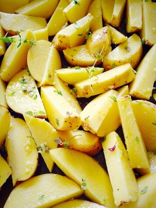 Sprinkle over the Thyme and minced Garlic and then mix thoroughly so that each wedge is coated in oil, garlic and thyme.