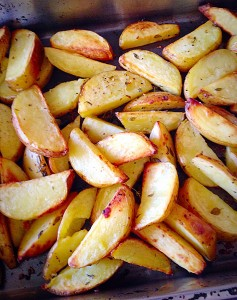 Hot Baked Garlic Herb Potato Wedges - straight from the oven.