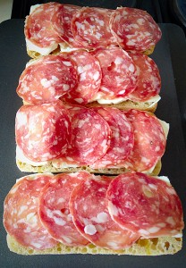Then top with slices of salami.