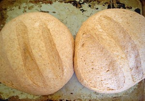 15 minutes before your loaves are ready, preheat your oven to it's highest setting.