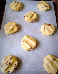 Using clean damp hands, use you fingers to press down and flatten the cookie balls.
