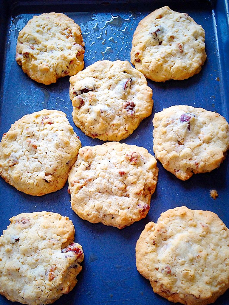 Freshly baked biscuits on a baking tray.