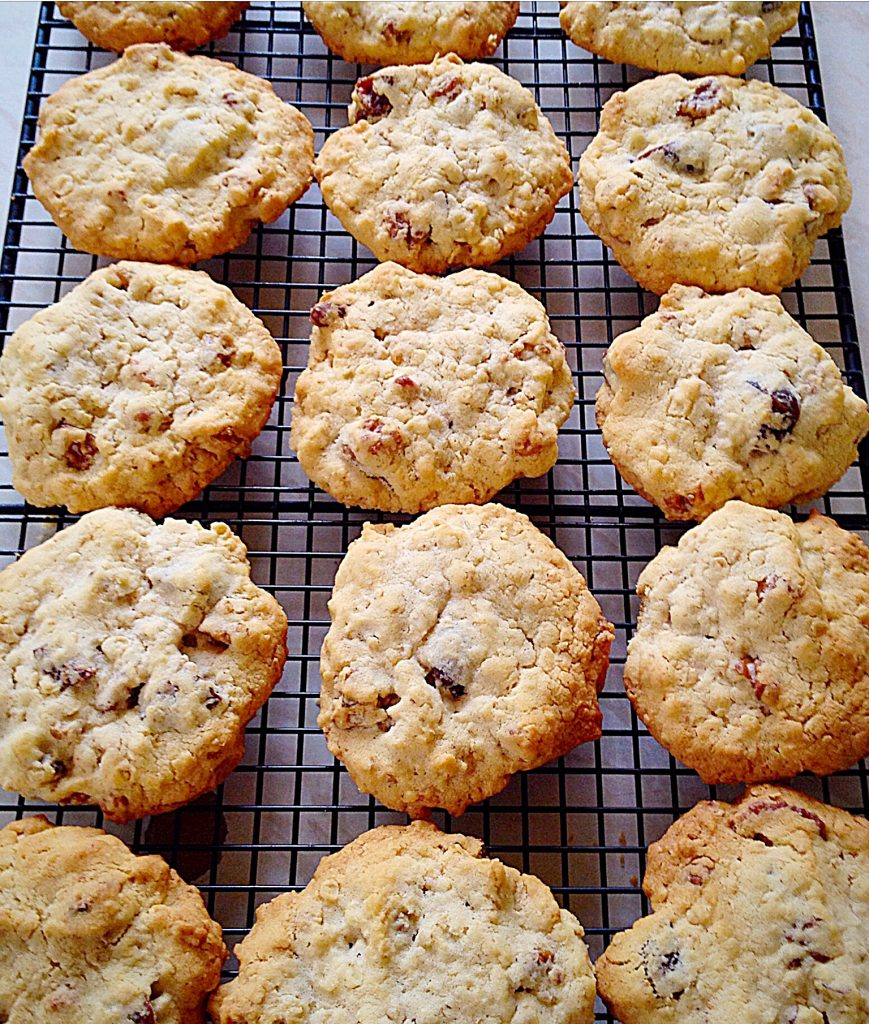 Fruit and nut biscuits on a cooling rack.