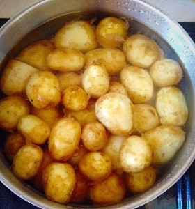 Place the potatoes in a saucepan, cover with water and bring to the boil.