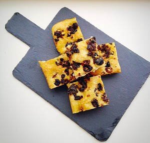 Sundried Tomato Olive Focaccia Bread - beautifully displayed on this slate board.