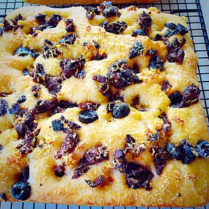 Sundried Tomato Olive Focaccia Bread - cooling on a rack.