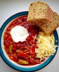 Chunky Chilli - served with a dollop of natural yoghurt, grated cheese and a thick slice of malted granary bread.
