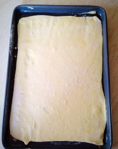 Using your rolling pin transfer the pastry to the baking tray.