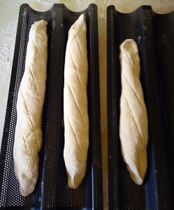 Place the baguette roll in the tray and using a very sharp knife slash lightly through the dough as in the photo.