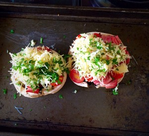 Top the mushrooms with grated cheese and parsley. Press down lightly so the topping is secure.