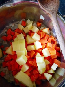 Add the carrots and potatoes to the softened onions.