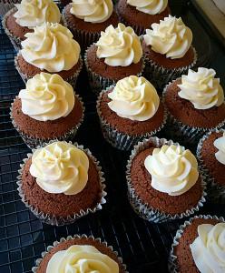 Black Forest Cupcakes pipe a small swirl of mascarpone cream onto the chocolate sponge.