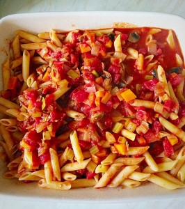 Cheesy Vegetable Pasta Bake, pour the pasta/vegetable mix into a baking dish.
