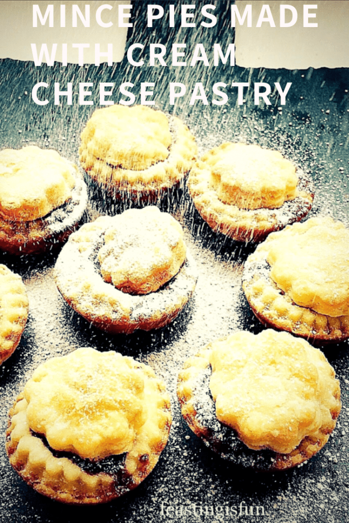 Christmas baked mince pies using an easy cream cheese pastry recipe. Dusted with festive icing sugar snow.