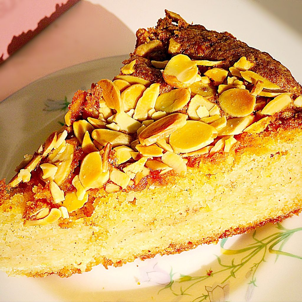 A slice of Autumn Apple Almond Cake