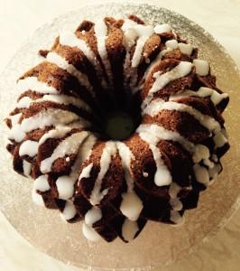 Lime Coconut Blossom Bundt Cake drizzle the lime glaze over the cake. www.feastingisfun.com