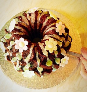 Lime Coconut Blossom Bundt Cake sing Happy Birthday and cut into this beautiful cake. www.feastingisfun.com