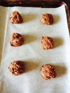"Using an ice cream scoop make 1"" balls of cookie dough."