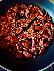 In a dry pan, heat the pecan nuts, gently tossing to ensure even toasting, for five minutes. Set aside to cool.