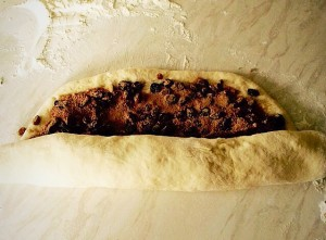Roll up the dough as tightly as possible.