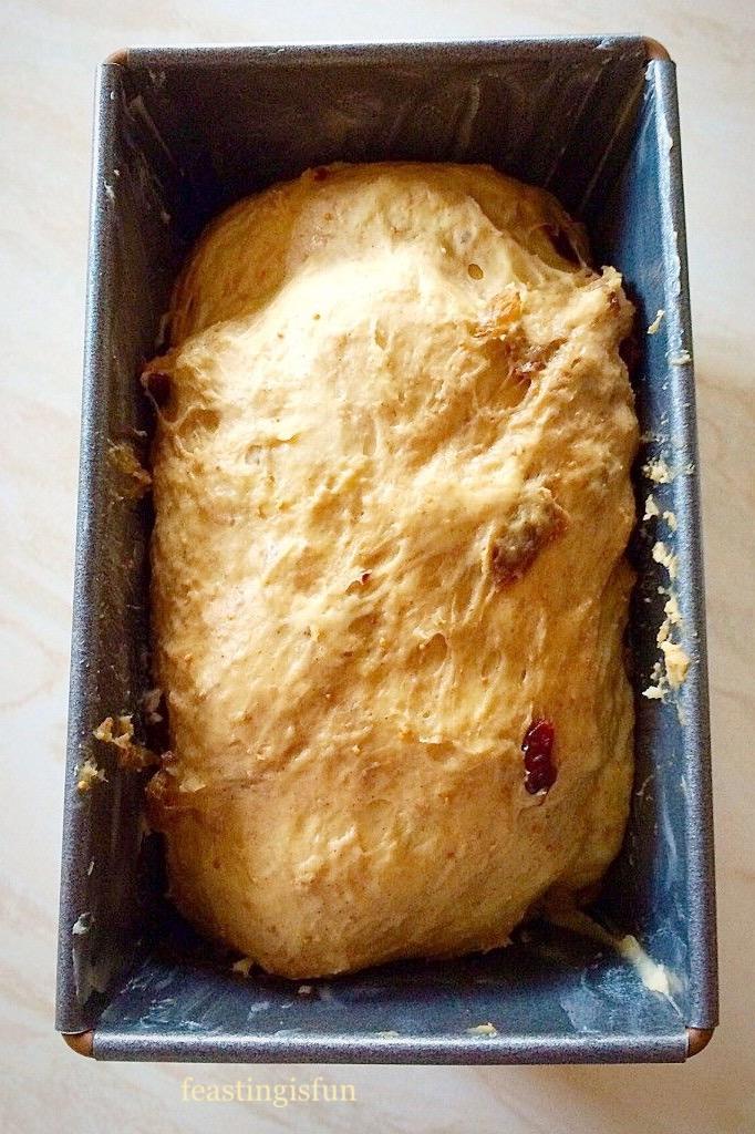 Unbaked spiced fruit bread loaf.