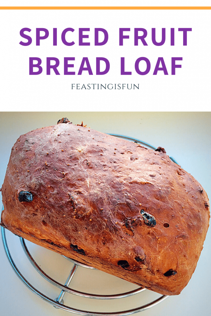Pinterest image of spiced fruit bread loaf with descriptive graphics.