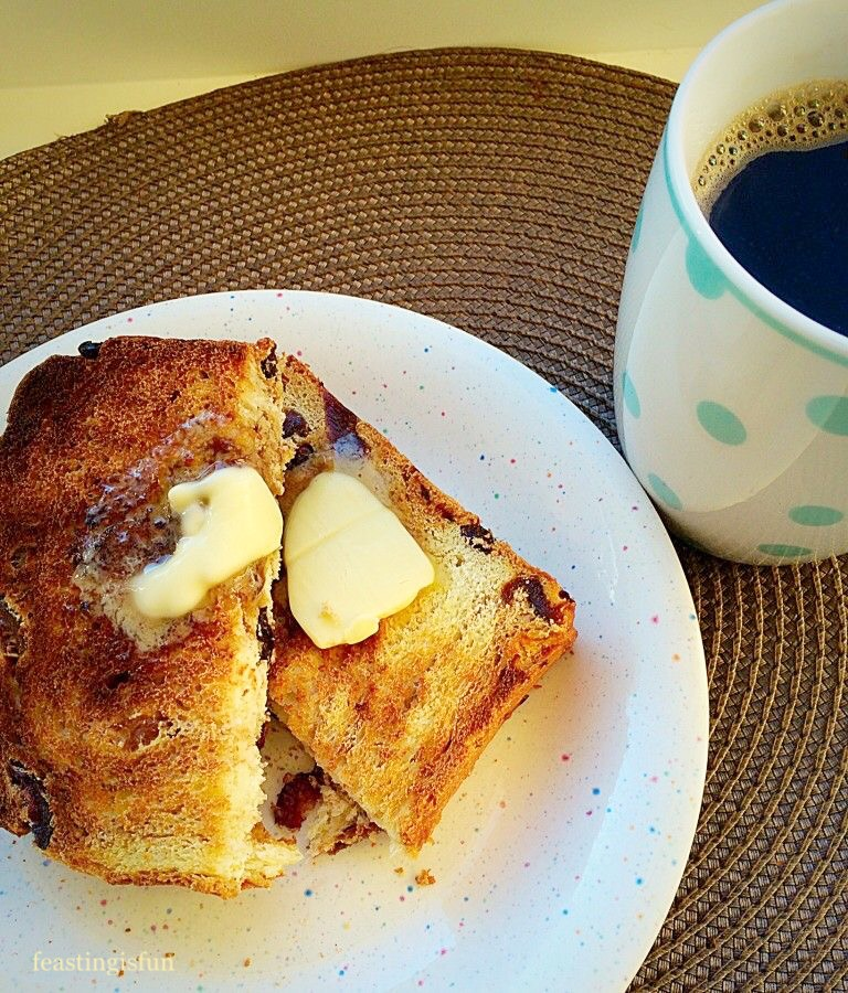 Spiced Fruit Loaf sliced and toasted with butter.