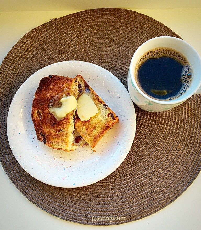 Breakfast with back coffee and toasted fruit bread.
