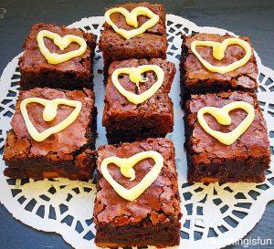 Chocolate fudge brownie bites served on a slate platter.