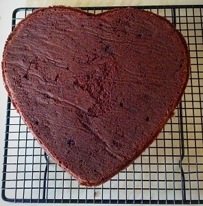 Chocolate Heart Cake turn the slightly cooled cake out, bottom side up, onto a cooling rack.