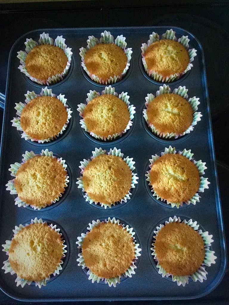 Baked, golden Vanilla Bean Cupcakes.