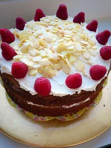 Raspberry Almond Cream Cake moist sponge layered with cream, jam and fresh fruit www.feastingisfun.com