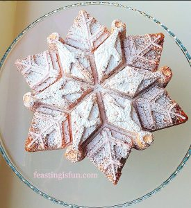 Vanilla cake in the shape of a snowflake.