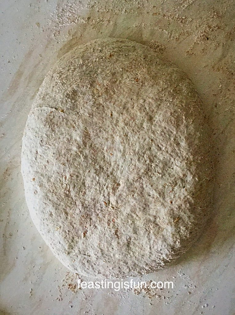 Flatten out the dough into a rough oval.