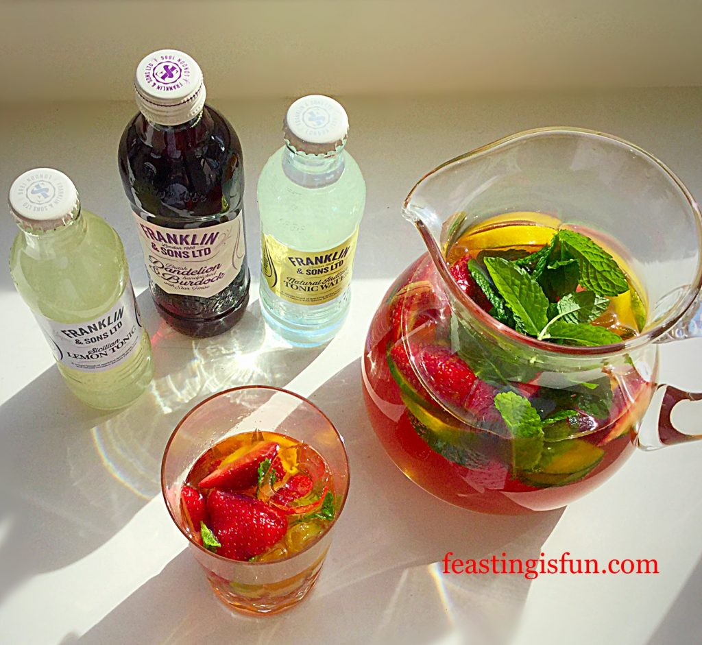 Franklins Fruity Summer Drink packed with fresh fruit and ice.