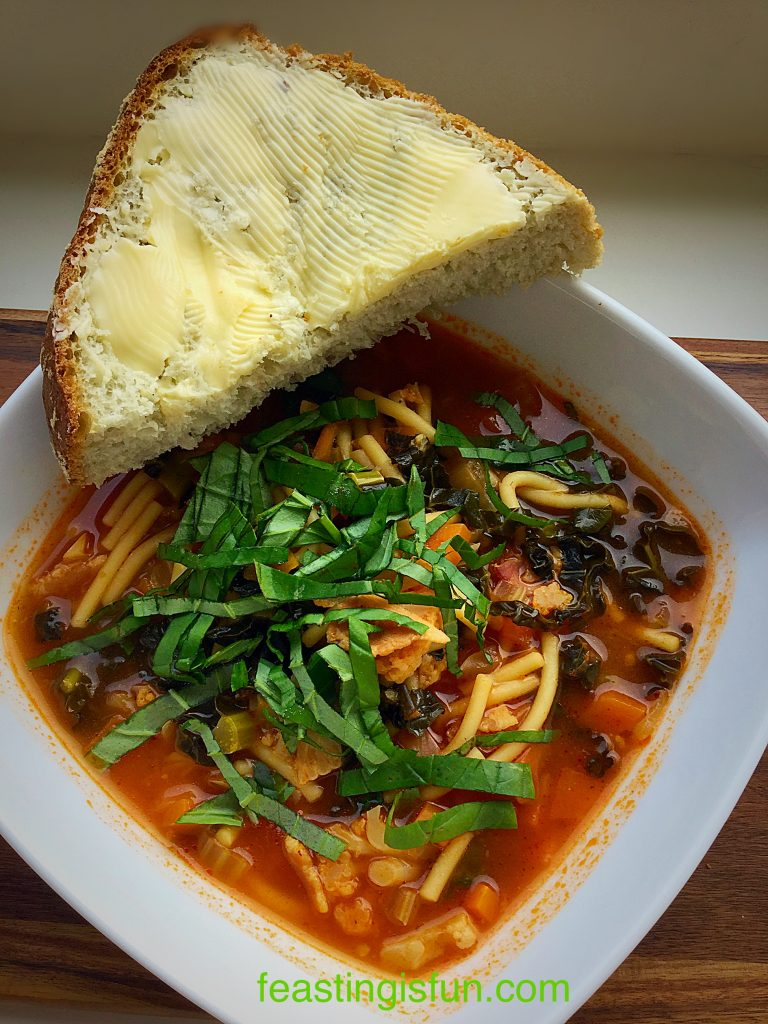 Hearty Minestrone Soup served with crunch bread.