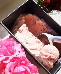 Strawberry Rose Ice Cream scoops in a tin.
