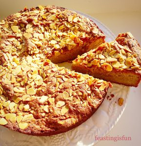 Gluten free apple and almond cake with a slice cut.
