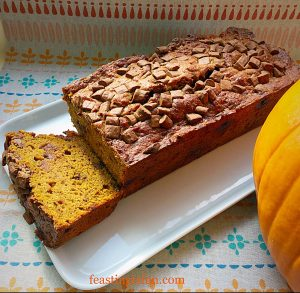 Chocolate Chip Pumpkin Loaf Cake sliced at one end to show the tender crumb.