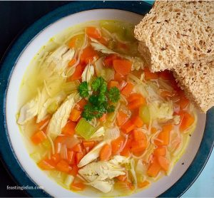 Roast Chicken Noodle Soup served with rustic homemade bread.